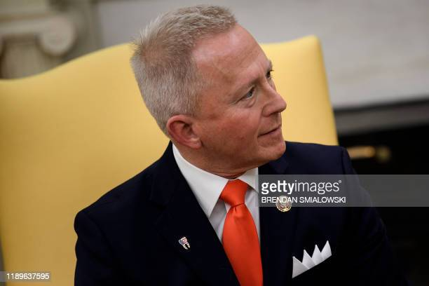 Rep Jeff Van Drew who is switching from the Democratic Party to the Republican Party listens to US President Donald Trump during a meeting in the...