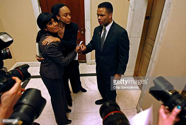 Rep Jesse Jackson Jr talks to the news media as his wife Sandi Jackson and his sister Jacqueline Lavinia Jackson embrace after a news conference at...
