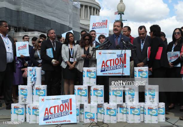 Rep Jesus Garcia speaks during a news conference to call on President Trump and Congress to help Puerto Rico recover two years after the island was...