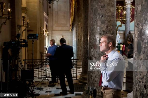 Rep Jim Clyburn DSC left and Rep Jim Jordan ROhio right prepare to do a television news interviews in Statuary Hall in the Capitol on Wednesday Nov 7...