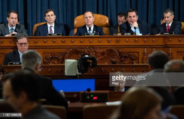 Rep Jim Himes Democratic Counsel Daniel Goldman Chairman Adam Schiff Ranking Member Devin Nunes and Republican Counsel Steve Castor listen to top US...