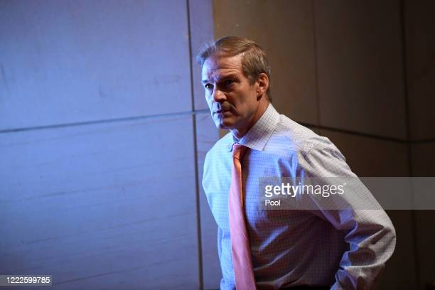 Rep Jim Jordan attends a House Judiciary Committee hearing on oversight of the Justice Department and a probe into the politicization of the...