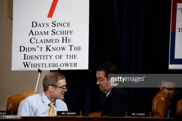 Rep Jim Jordan confers with ranking member Rep Devin Nunes during testimony by Gordon Sondland the US ambassador to the European Union before the...
