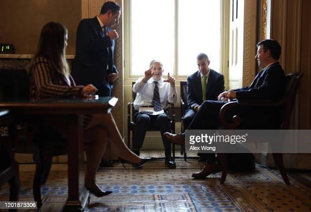 S Rep Jim Jordan gestures as Rep Elise Stefanik counsel Steve Castor and Rep Mike Johnson look on prior to the Senate impeachment trial against...
