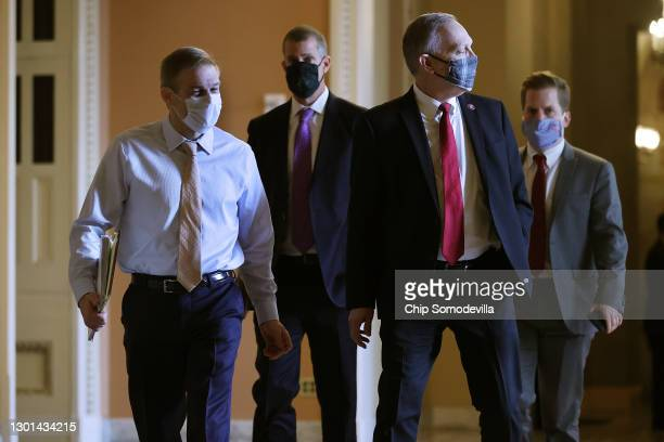 Rep. Jim Jordan , lawyer Stephen Castor and Rep. Andy Biggs walk across the U.S. Capitol on the second day of former President Donald Trump's second...