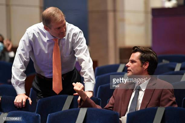 Rep Jim Jordan left talks with Rep Matt Gaetz before the start of a House Judiciary Committee hearing on oversight of the Justice Department and a...