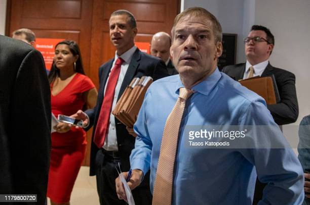 S Rep Jim Jordan listens to Rep Adam Schiff Chairman of the House Select Committee on Intelligence Committee speak at a press conference at the US...