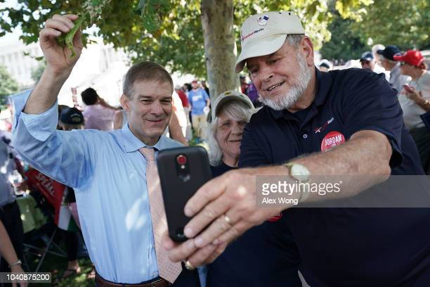 S Rep Jim Jordan poses for selfies with supporters during a rally hosted by FreedomWorks September 26 2018 at the West Lawn of the Capitol in...