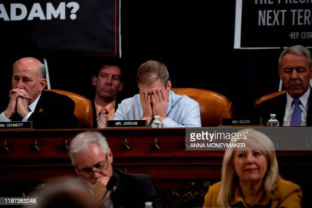 Rep Jim Jordan puts his face in his hands during a public impeachment inquiry hearing with the House Judiciary Committee on Capitol Hill in...