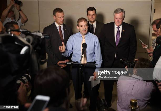 Rep Jim Jordan ranking member of the House Oversight Committee speaks with fellow Republican members of the House at the US Capitol on October 08...
