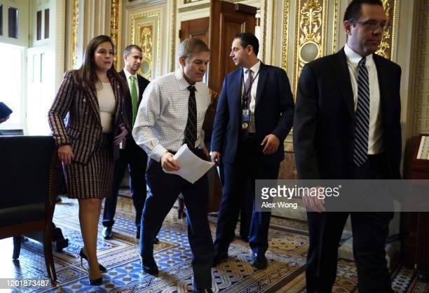 Rep. Jim Jordan , Rep. Elise Stefanik and counsel Steve Castor are seen outside the Senate chamber prior to the Senate impeachment trial against...