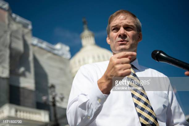 Rep Jim Jordan ROhio talks with members of the media as he departs after the last votes of the week on Capitol Hill on Friday Sept 27 2019