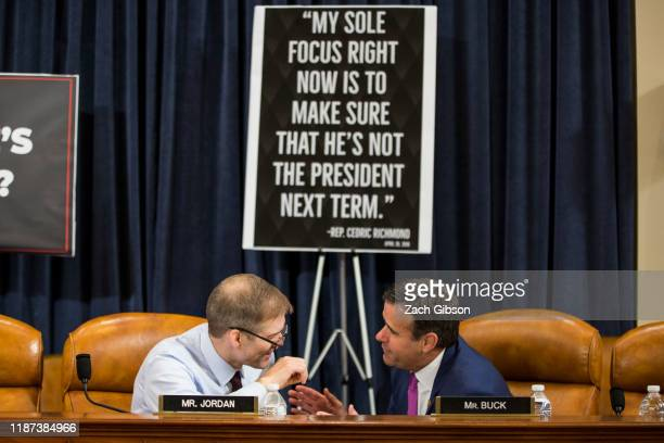 Rep. Jim Jordan, speaks to Rep. John Ratcliffe during break during a House Judiciary Committee hearing questioning staff lawyer Stephen Castor,...