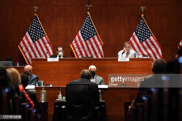 Rep. Jim Jordan , upper right, listens to Attorney General William Barr who is appearing before the House Oversight Committee on July 28, 2020 on...