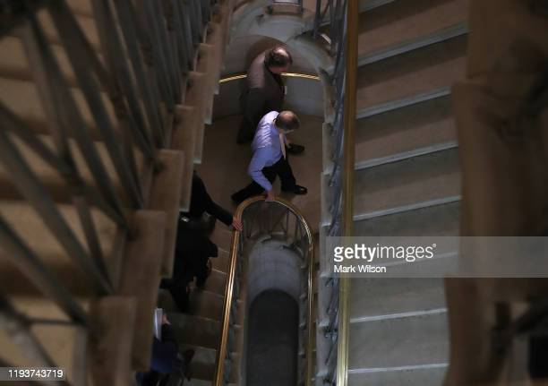 Rep Jim Jordan walks down a flight of stairs after the Committee voted to approve two articles of impeachment against US President Donald Trump in...