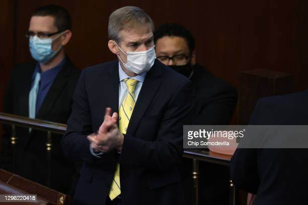 Rep. Jim Jordan watches as the House votes to impeach U.S. President Donald Trump for the second time in little over a year in the House Chamber of...