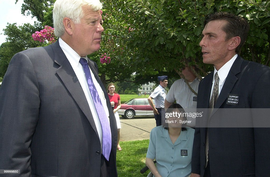 Rep. Jim McDermott (D-WA), left, discussess stem cell research funding with Michael Manganiello, right, Senior Vice President of the Christopher Reeve Paralysis Foundation. Between them are Sue and her husband Jay Pendelton, in tree. Sue desperately wants funding for stem cell research, to 'get me outta' this chair.'