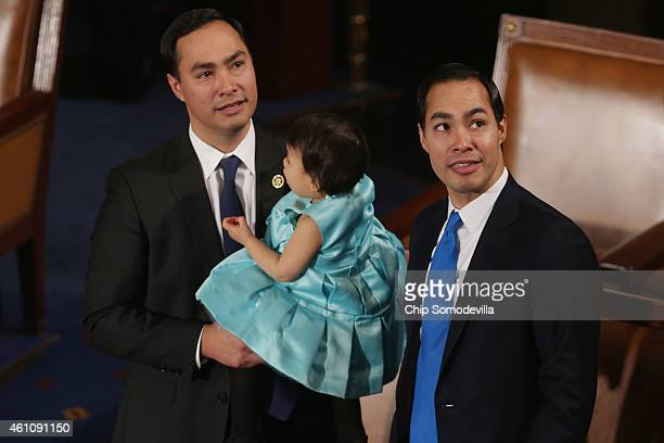 Rep Joaquin Castro holds his daughter Andrea Elena Castro as he and his twin brother Housing and Urban Development Secretary Julian Castro attend the...