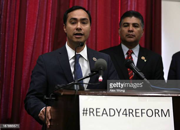 S Rep Joaquin Castro speaks as Rep Tony Cardenas listens during a news conference on immigration reform November 13 2013 on Capitol Hill in...