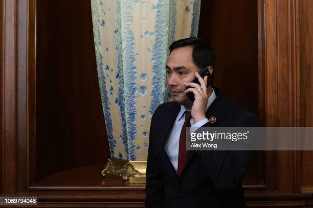 S Rep Joaquin Castro talks on his phone prior to a news conference at the US Capitol January 4 2019 in Washington DC US Speaker of the House Rep...