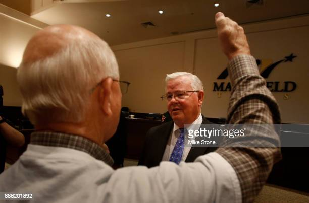 Rep Joe Barton listens as Mike Leyman of Mansfield Texas makes a point following a town hall meeting at Mansfield City Hall on April 13 2017 in...