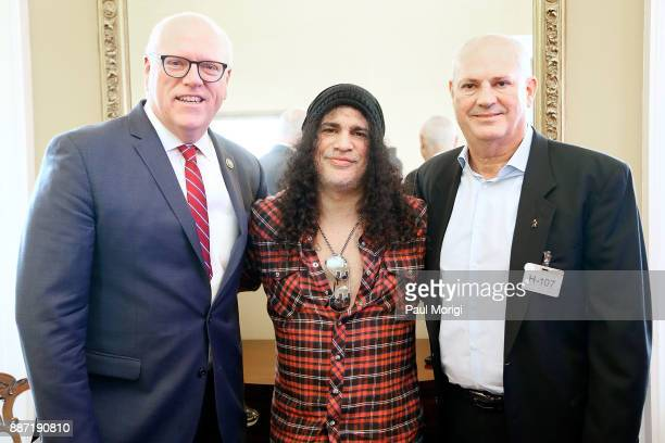 Rep Joe Crowley Slash of Guns N' Roses and Producer Mike Clink pose for a photo before the SLASH Holiday Reception hosted by The Recording Arts and...