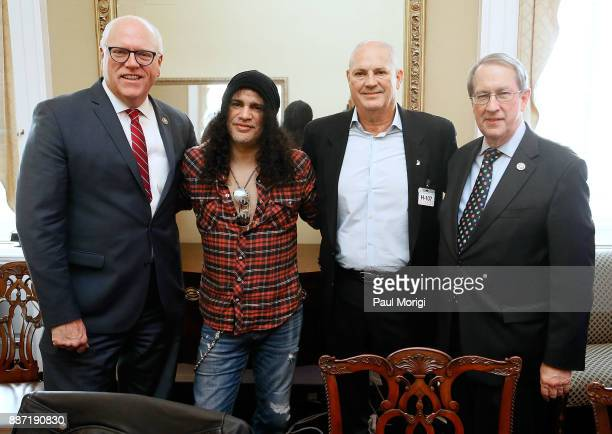 Rep Joe Crowley Slash of Guns N' Roses Producer Mike Clink and Committee Chairman Rep Bob Goodlatte pose for a photo before the SLASH Holiday...