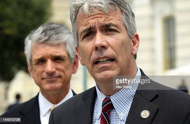 S Rep Joe Walsh speaks as Rep Scott Rigell listens during a news conference to announce the formation of the 'Fix Congress Now Caucus' May 16 2012 on...