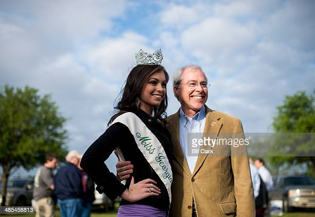 Rep John Barrow DGa poses for photos with 2014 Miss Georgia Sweet Onion Sarah DeLoach at the Law Enforcement Cookout at Wayne Dasher's pond house in...