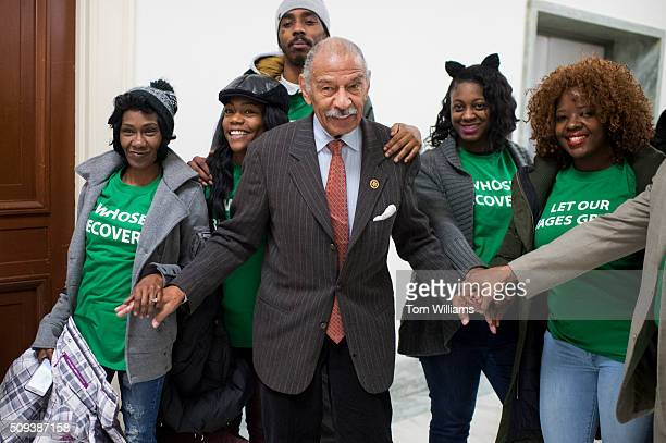 Rep John Conyers DMich poses for a picture with members of the Center for Popular Democracy outside of a House Financial Services committee hearing...