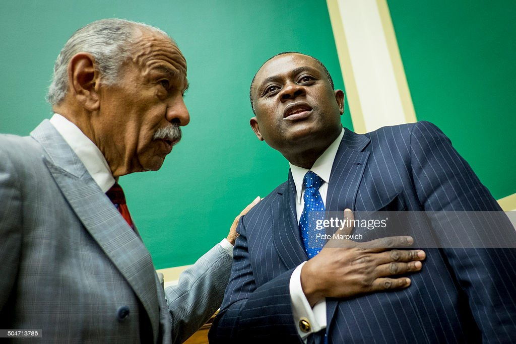 Rep. John Conyers (D-MI) greets forensic pathologist and neuropathologist, Dr. Bennet Omalu before a briefing sponsored by Rep. Jackie Speier (D-CA) on Capitol Hill on January 12, 2016 in Washington, DC. Dr.Omalu is credited with discovering chronic traumatic encephalopathy, or CTE, in former NFL players.