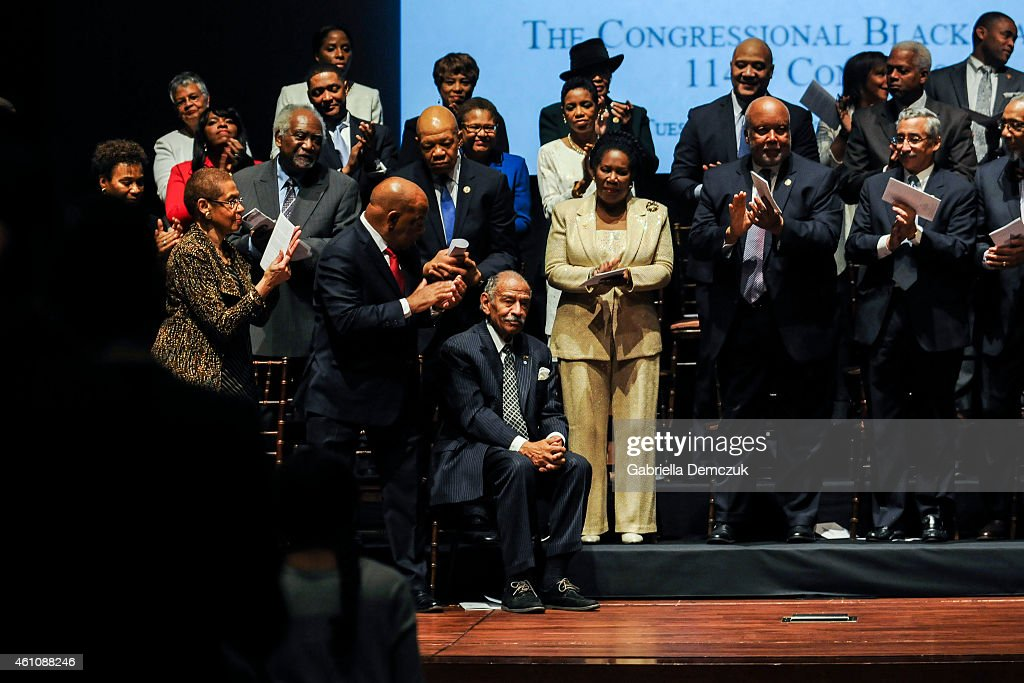 Rep. John Conyers (D-MI) is applauded for his tenure with the Congressional Black Caucus during the swearing-in ceremony at the U.S. Capitol on January 6, 2015 in Washington, D.C. The Congressional Black Caucus Foundation hosts a ceremonial swearing-in event for current and newly-elected members of the 114th Congress.