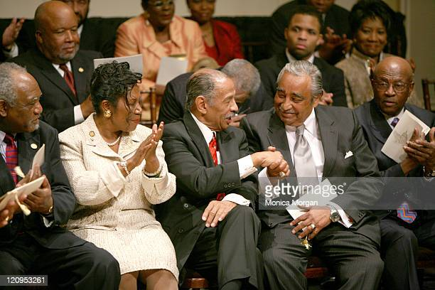 Rep John Conyers Jr DMI congratulates Rep Charles Rangel DNY during the Ceremonial SwearingIn of The Congressional Black Caucus 110 Congress at The...