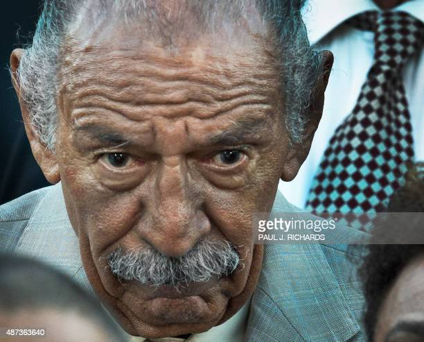 US Rep John Conyers listens as US House of Representatives Minority Leader Nancy Pelosi speaks during a press conference about the Iran nuclear deal...