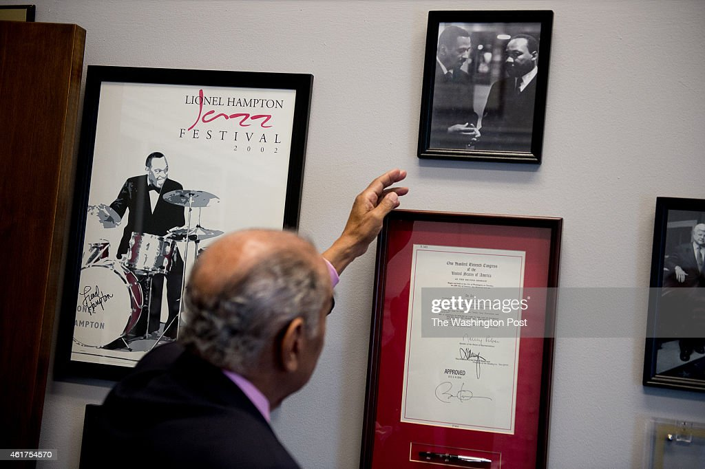 Rep. John Conyers (D-Mich.) points to a photo taken of himself with Dr. Martin Luther King Jr. that hangs on the wall at his office on Capitol Hill on January 14, 2015 in Washington, DC. Conyers is now the longest-serving member of the House.