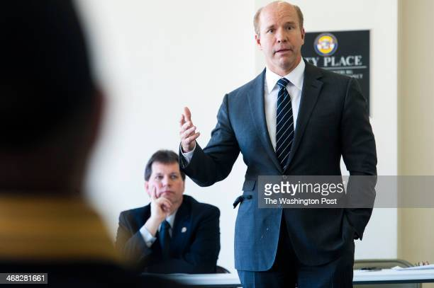Rep John Delaney right talks about his voting record at the State of the District Roundtable attended by Allegany and Garrett County elected...