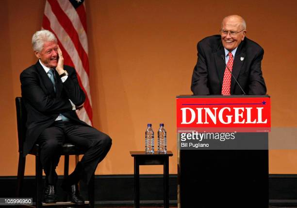 Rep John Dingell speaks as former President Bill Clinton listens at a rally to get out the vote for the midterm elections October 24 2010 in Ann...