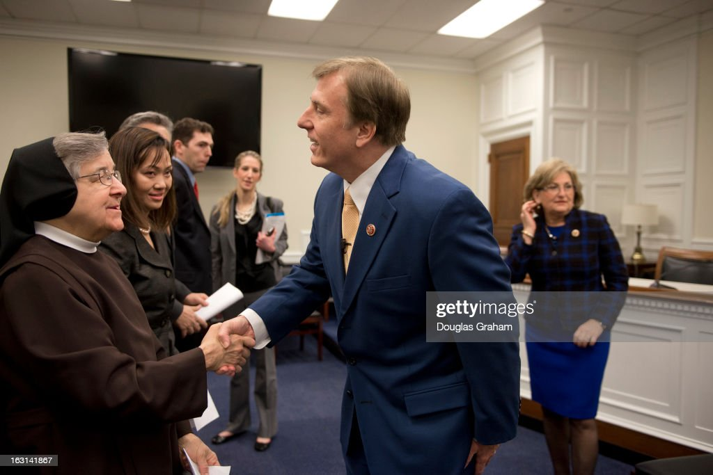 Rep. John Fleming, R-La., greets Sister Jane Marie Klein, Chairwoman of the Board of Franciscan Alliance, Inc., and Rep. Diane Black, R-Tenn., before the start of a news conference to introduce the 'Religious Freedom Bill,' which would 'stop the Obama administration's assault on pro-life religious freedom via the HHS (Health and Human Services) mandate' and exempt 'medical professionals who refuse to be involved with the performance of abortions.'
