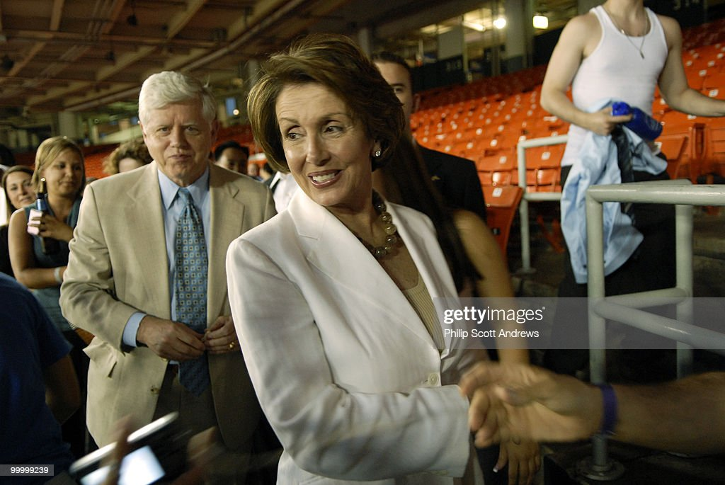 Rep. John Larsen-D, Conn, and House Majority Leader Nancy Pelosi, greet fans as they walk to their seats at RFK stadium, Pelosi's appearance wasn't entirely cheered, when announced, she was booed, and on reference to a foul ball, one republican fan said 'I hope it hits Nancy.'