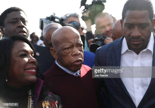 Rep John Lewis arrives to speak to the crowd at the Edmund Pettus Bridge crossing reenactment marking the 55th anniversary of Selma's Bloody Sunday...