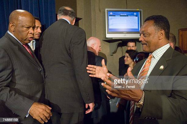 Rep John Lewis DGa and Rainbow/PUSH Coalition and civil rights leader Jesse Jackson embrace after a news conference following the vote in the Senate...