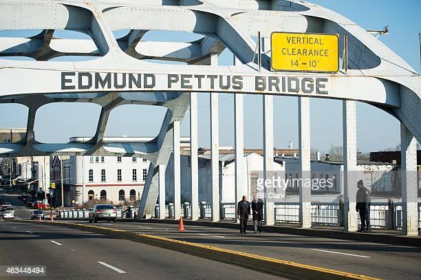 Rep John Lewis DGa walks across the Edmund Pettus Bridge with Bob Schieffer of CBS News on Saturday Feb 14 2015 Rep Lewis was beaten by police on the...