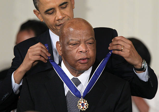 Rep. John Lewis is presented with the 2010 Medal of Freedom by President Barack Obama during an East Room event at the White House February 15, 2011...