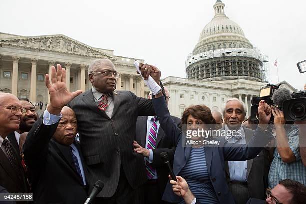 Rep John Lewis James Clyburn Maxine Waters and Charles Rangel right speak with supporters outside the US Capitol building June 23 2016 in Washington...