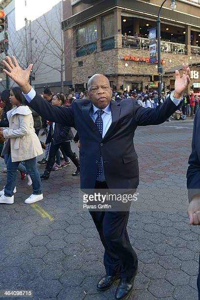 Rep John Lewis participates in the 2014 Martin Luther King Jr March Rally at Peachtree Street on January 20 2014 in Atlanta Georgia