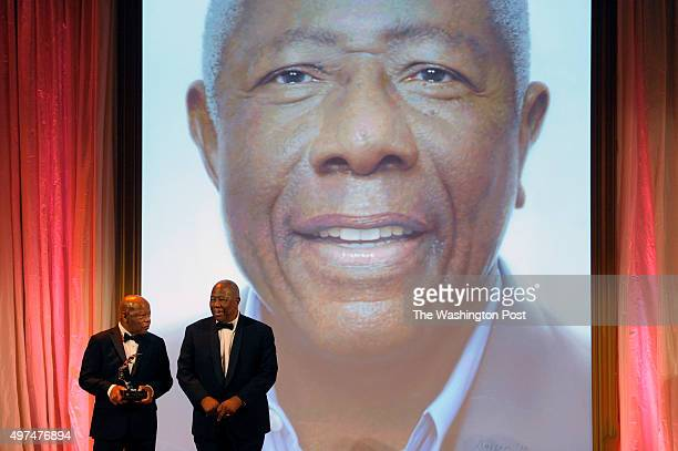 Rep John Lewis presents the award to baseball legend Hank Aaron at the National Portrait Gallery November 15 2015 in Washington DC The honorees of...