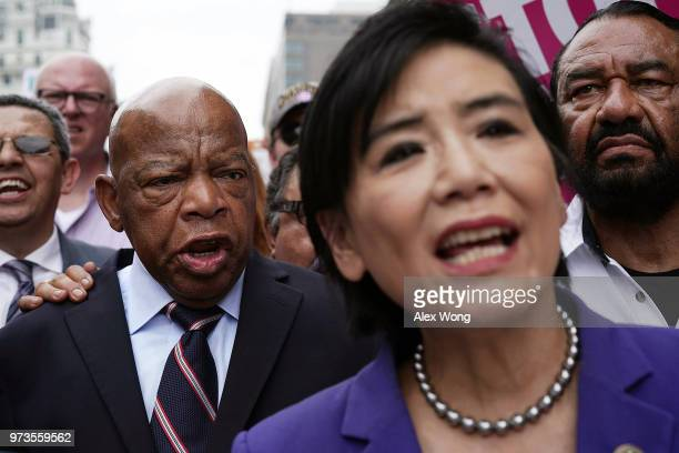 S Rep John Lewis Rep Judy Chu and Rep Al Green march to the headquarters of US Customs and Border Protection during a protest June 13 2018 in...