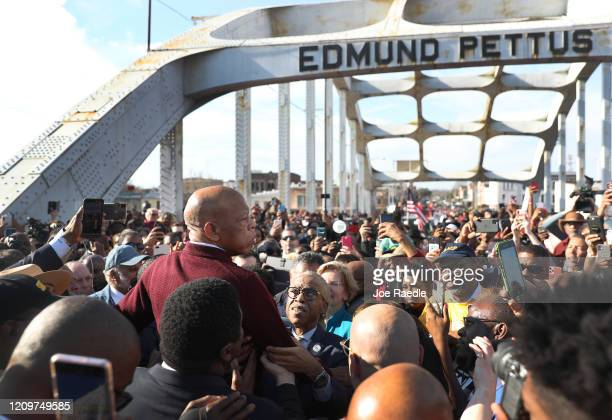 Rep. John Lewis speaks to the crowd at the Edmund Pettus Bridge crossing reenactment marking 55th anniversary of Selma's Bloody Sunday on March 1,...