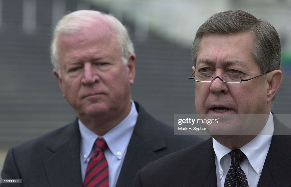 Rep. John Linder (R-GA), left, joined fellow Georgia Rep. Saxby Chambliss (R-GA) for a rainy news conference at the House Triangle on Tuesday morning that outlined the Center for Disease Control's need for funds for building repair and new site for additional buildings.