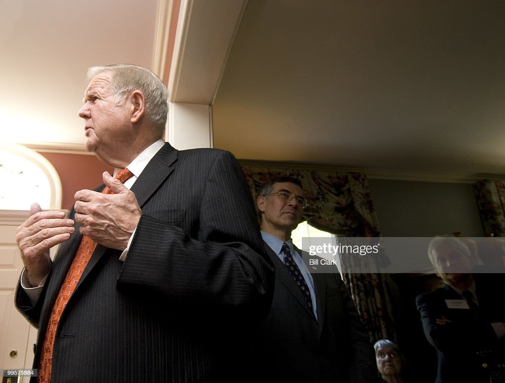 Rep. John Murtha, D-Pa., left, and Rep. Rush Holt, D-N.J., right, speak to guests at a fundraising event for Holt in the home of David and Catherine Loevner in Princeton, N.J., on Friday, Oct. 13, 2006.